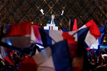 French President-elect Emmanuel Macron celebrates on the stage at his victory rally near the Louvre in Paris