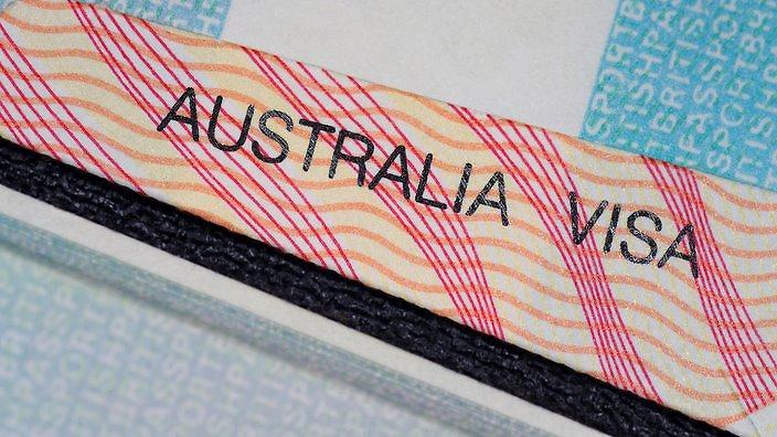 australian visa in between two british passport pages